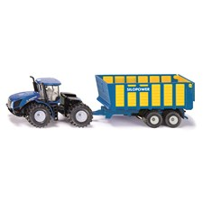 New Holland Knicklenker mit Silagewagen